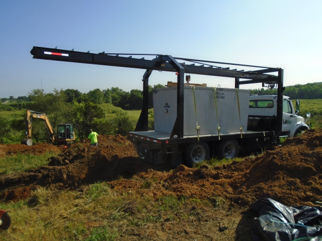 Our 1200 gal three chamber septic tank being delivered.